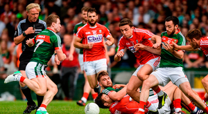 Aidan O'Shea of Mayo looks on as he tussles with Jamie O'Sullivan of Cork