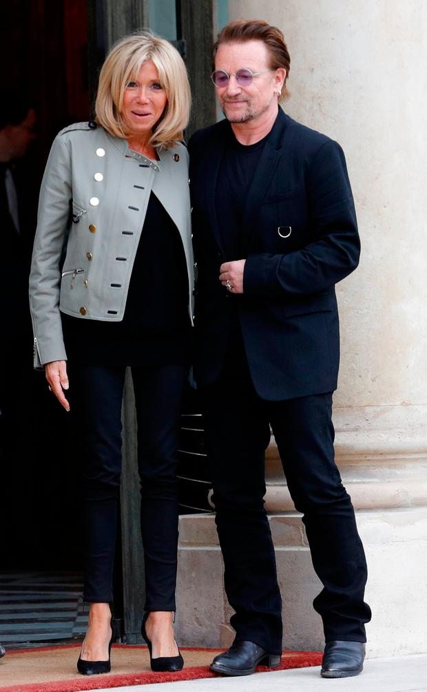 Singer Bono of Irish band U2 and co-founder of ONE organization and Brigitte Macron, wife of the French President, speak at the Elysee Palace in Paris, France, July 24, 2017. REUTERS/Philippe Wojazer