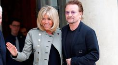 Singer Bono of Irish band U2 and co-founder of ONE organization and Brigitte Macron, wife of the French President, speak at the Elysee Palace in Paris, France, July 24, 2017. REUTERS/Philippe Wojazer TPX IMAGES OF THE DAY