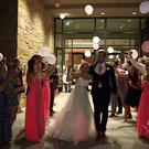 Newlyweds Hana Haka and Tyler Noland exit their wedding reception cheered on by friends and family | Photo: YouTube ALX BMGINC