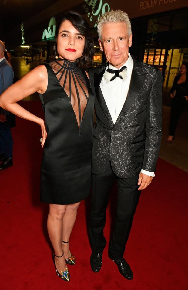 Mariana De Carvalho (L) and Adam Clayton attend the GQ Men Of The Year Awards 2016 at the Tate Modern on September 6, 2016 in London, England. (Photo by David M. Benett/Dave Benett/Getty Images)