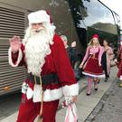 People dressed as Santa Claus take take part in the World Santa Claus Congress