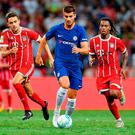 Alvaro Morata #9 of Chelsea FC runs with the ball during the International Champions Cup match between Chelsea FC and FC Bayern Munich at National Stadium in Singapore