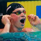 Britain's Adam Peaty celebrates after setting a new world record in a men's 50-meter breaststroke semifinal during the swimming competitions of the World Aquatics Championships in Budapest, Hungary