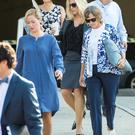 Molly Corbett, 33, left, (blue dress) arrives at the Davidson County Courthouse in Lexington, North Carolina, USA, on Tuesday, with her mother, Sharon Martens, right, and other family and friends for the Jason Corbett murder trial.