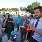 Minister Eoghan Murphy, right speaks with local man Sean Lynch
