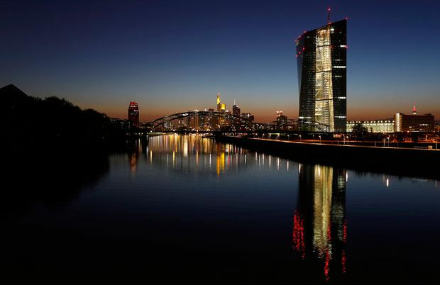 The headquarters of the European Central Bank (ECB) (R) is seen next to the famous skyline in Frankfurt. Photo: Reuters
