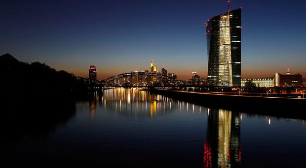 ECB sticks with QE but lifts its growth forecast