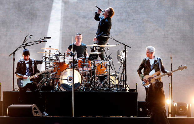 Adam Clayton (right) performing with his U2 bandmates at Croke Park Photo: Steve Humphreys