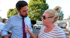 Housing and Local Government Minister Eoghan Murphy is addressed by local resident Angela Quinn in Stameen Estate, Drogheda, as he visits the town to see the water situation. Photo: Colin Keegan