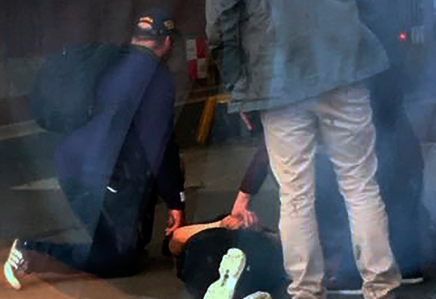 Gardai pin a suspect to the ground at Connolly Station.
