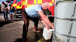 Former Ireland soccer team physio Mick Byrne at a water station in Ashbourne, Co Meath. Photo: Steve Humphreys