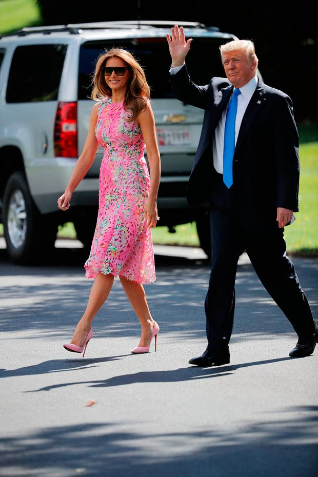 President Donald Trump (R) and first lady Melania Trump walk across the South Lawn before departing the White House July 25, 2017 in Washington, DC. Trump is traveling to Ohio to participate in a 'salute to American heroes' and a 'Make America Great Again Rally.' (Photo by Chip Somodevilla/Getty Images)