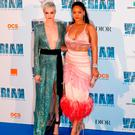 British model and actress Cara Delevingne (L) and Barbadian singer and actress Rihanna share a joke as they pose for a photograph upon arrival for the pre-premiere of the film