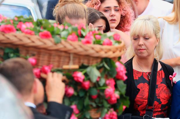 Mum Lisa Roussos looks on as the coffin of her daughter Saffie Roussos, who died in the Manchester Arena bombing, arrives at Manchester Cathedral for her funeral service. Photo: Danny Lawson/PA Wire