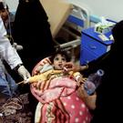 Woman gives her daughter rehydration fluid at a cholera treatment center in Sanaa, Yemen May 15, 2017. Picture taken May 15, 2017. REUTERS/Khaled Abdullah