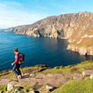 A woman on a walk along the Wild Atlantic Way at Slieve League in Co Donegal. Photo: Failte Ireland