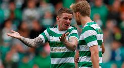 Jonny Hayes makes a point to team-mate Stuart Armstrong during last night's match at Parkhead. Photo: REUTERS