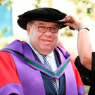 Former Taoiseach Brian Cowen with his wife Mary at Dublin Castle, where he accepted an honorary doctorate yesterday. Photo: Gerry Mooney