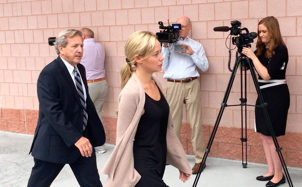 Molly Martens-Corbett enters court with her lawyer Walter Holton yesterday