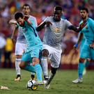 Lionel Messi of Barcelona (L) and Paul Pogba of Machester United (R)
