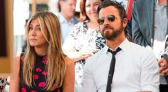 Actor Jennifer Aniston (L) and Justin Theroux attend Jason Bateman's star unveiling ceremony on the Hollywood Walk of Fame, on July 26, 2017, in Hollywood, California. / AFP PHOTO / VALERIE MACONVALERIE MACON/AFP/Getty Images