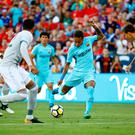 Barcelona's Neymar, center, shoots against Manchester United