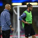 Head coach Zinedine Zidane (L) and Gareth Bale of Real Madrid look on during a training session ahead of the UEFA Champions League final between Juventus and Real Madrid at the National Stadium of Wales on June 2, 2017 in Cardiff, Wales. (Photo by Etsuo Hara/Getty Images)