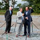 (left to right) Professor George Miley, Minister of State for Training, Skills, Innovation, Research and Development John Halligan and Professor Peter Gallagher from Trinity College take a tour of the I-LOFAR a powerful new radio telescope that covers the size of a football pitch has been switched on in Co Offaly. Photo: Niall Carson/PA Wire