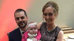 Laura Cafferty and her husband Karl with their daughter Maya (nine months)