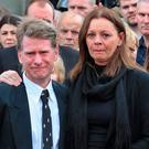 Dermot Byrne's brother Robert, left, wife Geraldine and daughters Shawna (with photograph) Emma, and Rebecca at his funeral. Photo: Colin Keegan, Collins Dublin