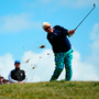John Daly hits an approach shot during the first round of the British Senior Open. Photo: Getty Images