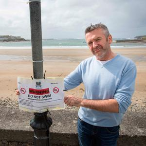 Johnny Redmond of the Strand Bistro at an almost deserted beach at Kilkee. Photo: Eamon Ward