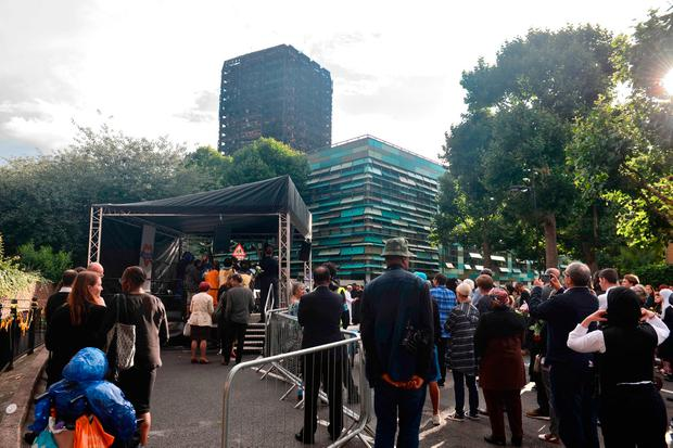 People hold a vigil near Grenfell tower. Photo: PA