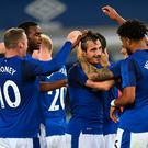 Everton's defender Leighton Baines celebrates with teammates, after scoring his goal. Photo: Getty Images