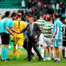 Celtic manager Brendan Rodgers shakes hands with the match officials after the UEFA Champions League third round qualifying round, first leg match at Celtic Park, Glasgow
