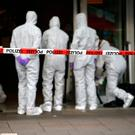 Police investigators work at the crime scene after a knife attack in a supermarket in Hamburg, Germany. REUTERS/Morris Mac Matzen