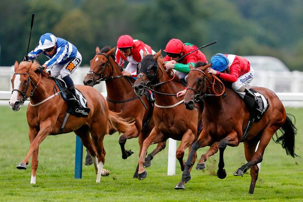 On Her Toes, with Joe Fanning Up (right) on the way to winning the Valiant Stakes at Ascot yesterday. Photo by Alan Crowhurst/Getty Images