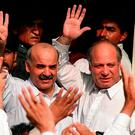 In this photograph taken on December 4, 1999, shows deposed Pakistani Prime Minister Nawaz Sharif (R) and his brother Shahbaz Sharif (L) waving at supporters outside the courthouse in Karachi as they make their first public appearance together since the 12 October Military bloodless coup. / AFP PHOTO / AFP FILES / AAMIR QURESHIAAMIR QURESHI/AFP/Getty Images