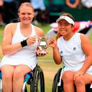 Jordanne Whiley (left) and Yui Kamiji with the trophy after winning the Ladies' Wheelchair doubles final