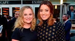 Actors Amy Poehler (L) and Aubrey Plaza at the premiere of Neon's
