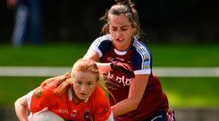 Armagh's Blaithin Mackin holds off a challenge from Karen McDermott of Westmeath. Photo by Sam Barnes/Sportsfile