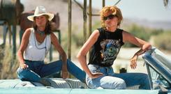 WILD WHISKEY AND STRONG WOMEN: Geena Davis and Susan Sarandon in the movie 'Thelma and Louise'