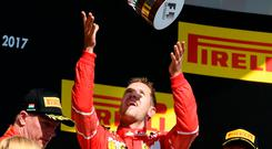 Sebastian Vettel throws the throphy in the air after his triumph in Hungary. Photo: Szilard Koszticsak /MTI via AP