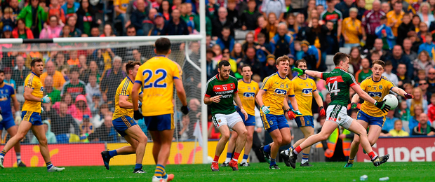 Cillian O'Connor of Mayo attempts a kick at scoring a point. Photo: Sportsfile