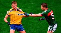 Mayo's Lee Keegan gets to grips with Enda Smith of Roscommon at Croke Park. Photo: Sportsfile