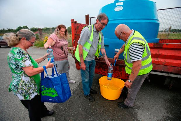Pictured in 2017: Residents at Termon Abbey in Drogheda queue for water supplied by the council. Photo: PA