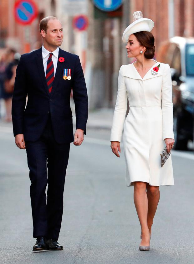 Britain's Prince William, the Duke of Cambridge and his wife Princess Kate, the Duchess of Cambridge make their way to the Last Post ceremony at the Menin Gate to mark the centenary of Passchendaele, The Third Battle of Ypres, in Ypres, Belgium July 30, 2017. REUTERS/Yves Herman