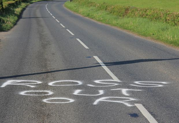 Graffiti on the road referring to Donovan Ross.