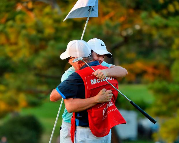 Rory McIlroy celebrates with caddie J.P. Fitzgerald in 2016. Photo: Stan Badz/PGA TOUR
